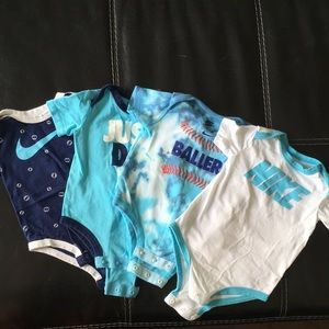 Nike set of 4 onesies 3/6 month